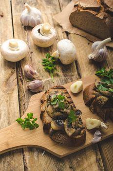 Mushroom mixture on rustic toast with garlic