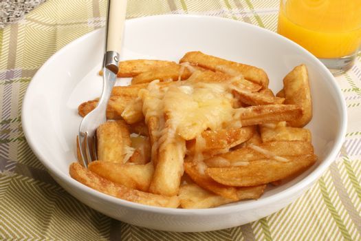 french fries with melted irish cheddar cheese and orange juice