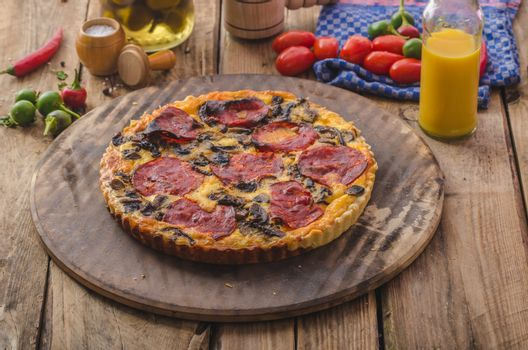 Delicious quiche with chorizo, nuts and sharp cheese