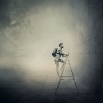 Abstract idea with a person climbing a ladder, in front of a concrete wall with no exit. Surrounded by limitations, daily routine.
