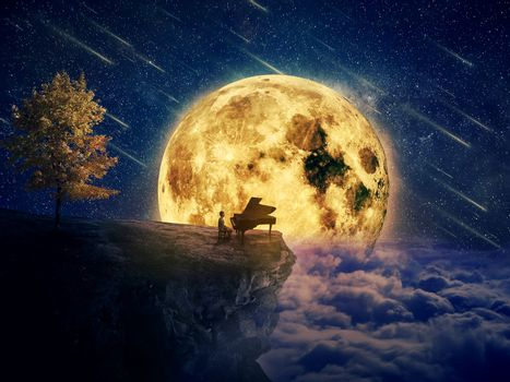 Night scene with a boy, musician standing at the edge of a cliff chasm with his piano. Waiting for music inspiration in the center of nature, over a full moon night background.