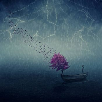 Surrealistic image as lonely boy floating in a wooden boat with a purple tree that cast its leaves in the wind. Lost in the middle of the sea, below the falling rain, journey and discovery.