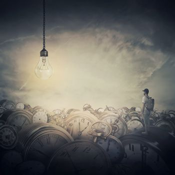 Surreal view as a man, with a bag in his back, stand in the midle of a clock trash looking at a huge light bulb glowing. Time pressure, hour perception and idea concept.