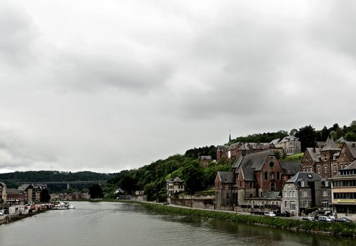 Landscape of Meuse River and Side View on Maison Leffe in Cloudy Day Outdoors.  Dinant, Belgium