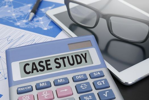 CASE STUDY  Calculator  on table with Office Supplies. ipad