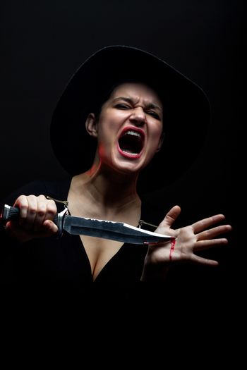 girl with a huge knife in pain