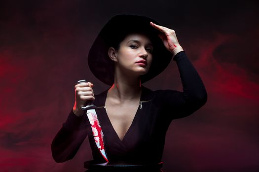 girl with a huge bloody knife portait