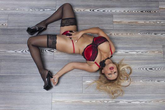 woman in underwear lying on the floor