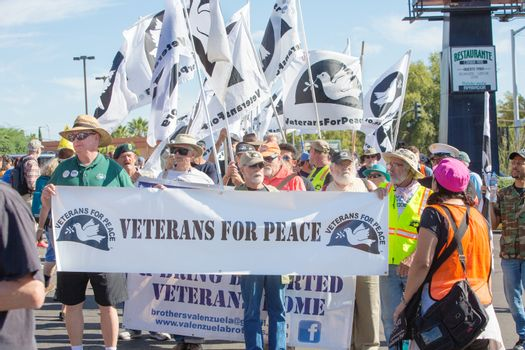 Men and Woman in Veterans for Peace at Nogales, AZ