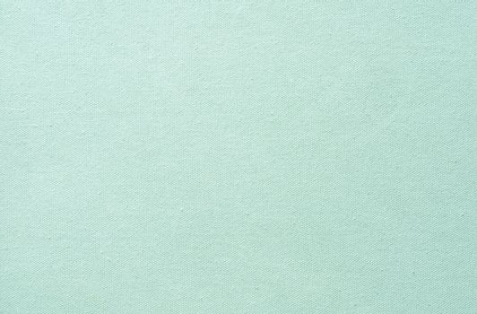 green pastel fabric background and texture