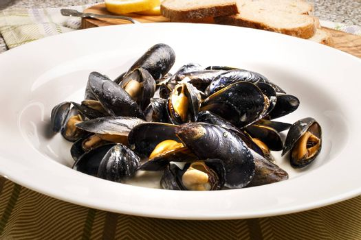 mussels with garlic sauce in a plate