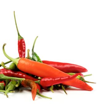 Stack of Perfect Red, Orange and Green Hot Chili Peppers Cross Section on White background