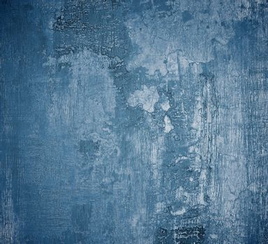 Blue and Light Grey Damaged Obsolete Cement Wall Background closeup