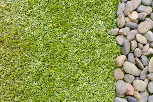 small stone on grass background