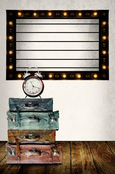 Vintage Light box program board with vintage travel bag and clock