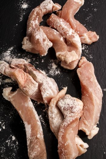 raw pork stripes  is well coated with flour