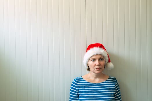 Disappointed woman with Christmas Santa Claus hat