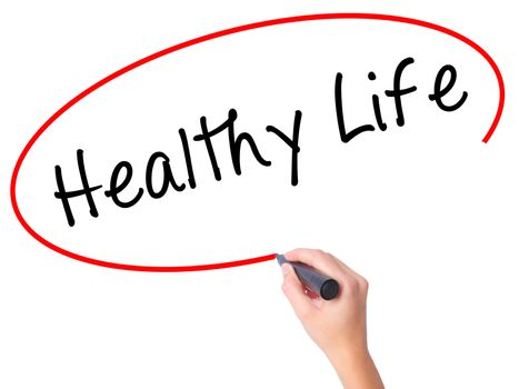 Women Hand writing Healthy Life black marker on visual screen. Isolated on white. Life, technology, internet concept. Stock Image