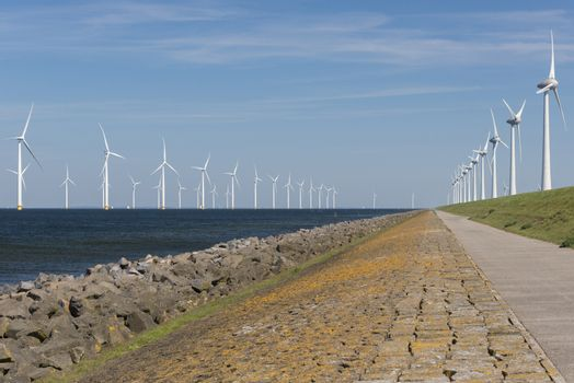 Wind park partly in the water and partly on the land in the Noordoostpolder in the Netherlands