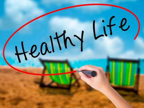 Man Hand writing Healthy Life black marker on visual screen. Isolated on white. Life, technology, internet concept. Stock Image