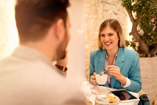 Businesspeople In A Cafe