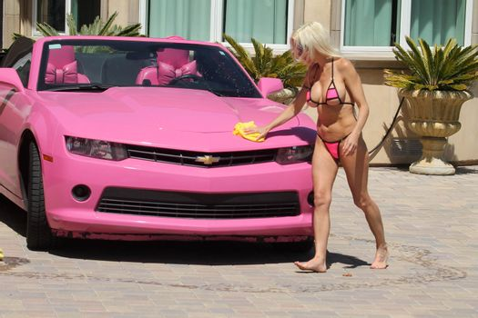 """Frenchy Morgan the """"Celebrity Big Brother"""" Star is spotted on a hot day wearing a tiny pink bikini while washing her pink car in Malibu, CA 05-22-17"""