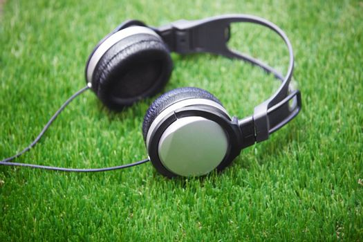 Headphones in a grass. Horizontal photo