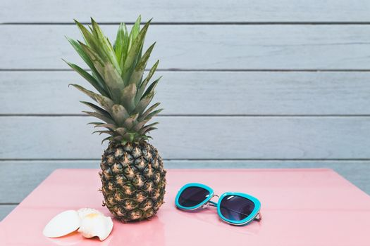 Pineapple on a blue pastel background .