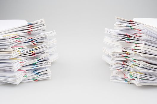 Dual pile overload of document with colorful paper clip