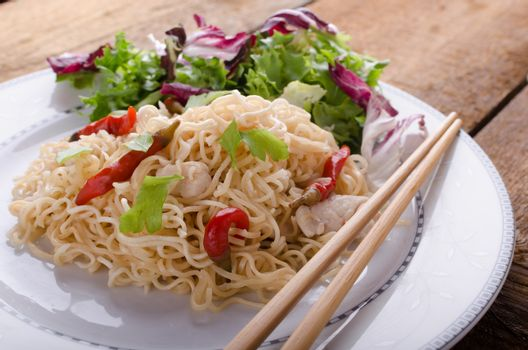 Chinese noodles with chicken and fresh salad