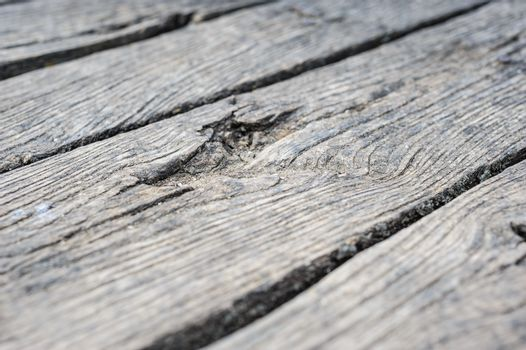Old aged cracked wood planks, natural organic pattern in perspective