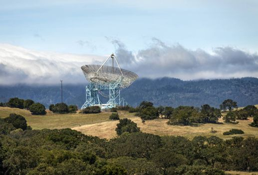 This image of Stanford Dish was taken at the old Leland Standord propert West of the campus. The property consists of rolling hills, trails, San Francisco bay and views of Silicon Valley. This shot was looking West look directly at the dish. The dish itself is a radio telescope used to explore the far reaches of space at Stanford University.