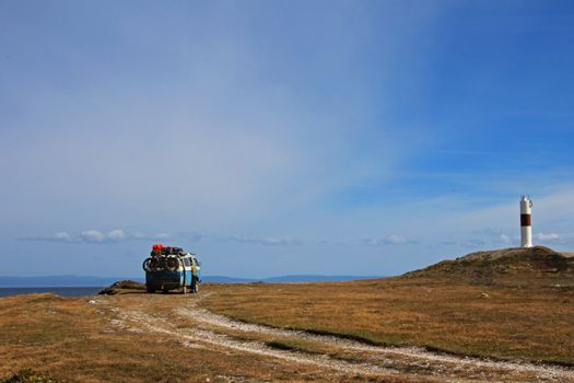 Van camping at the lighthouse and the bay of Porvernir, Tierra Del Fuego, Patagonia, Chile