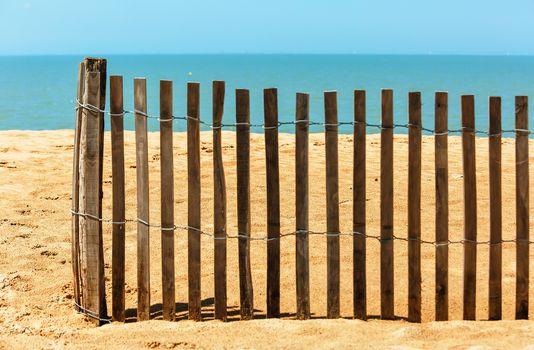 Palisades on sand beach near ocean. Private beach concept