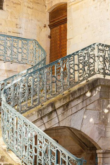 Vintage spiral wrought iron stairway of a church