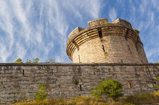 Ancient tower with stone wall