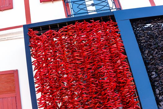A typical basque frontage with bunches of drying red pappers.