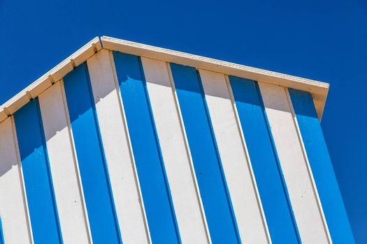 detail of cabin on a beach with blue sky on background