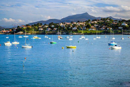 Saint jean de Luz bay with luxurious boats on a sea