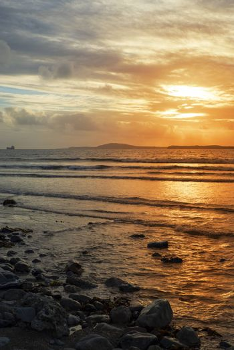 tanker in the shannon estuary near ballybunion on the wild atlantic way ireland with an orange sunset