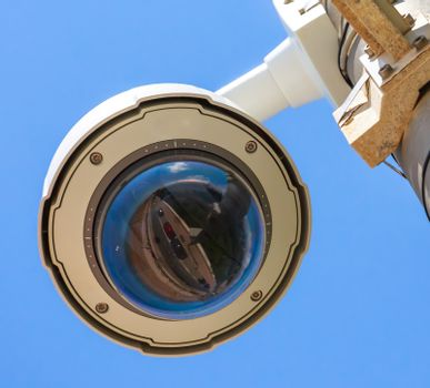 Security CCTV camera under blue sky