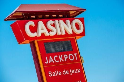 Casino sign on blue sky background