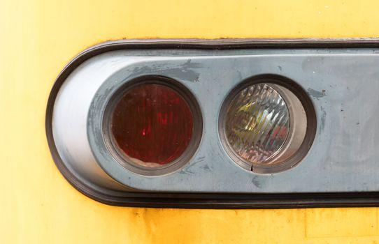 Closeup of a train headlight shining