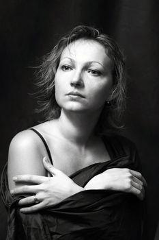 Portrait of the beautiful woman in studio