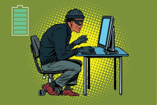 African hacker thief hacking into a computer