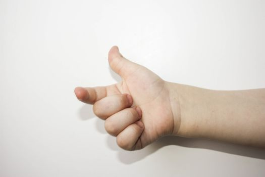 Finger counts one. Child. all is well. Over white background. Photo for your design
