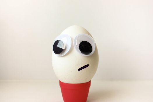 Bulging eyes. Egg with a funny painted