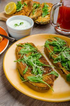 Breaded eggplant parmesan and arugula