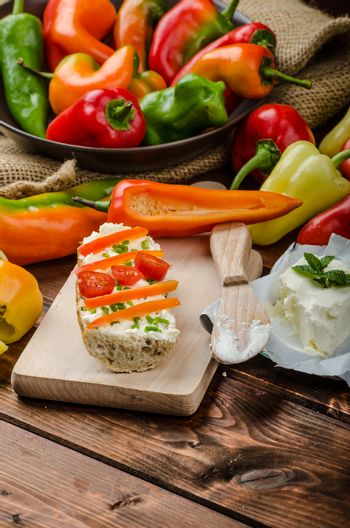 Healthy baguette, spread curd cheese with vegetable and herbs