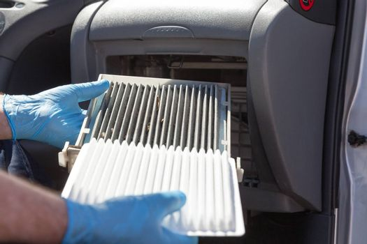 Clean and dirty cabin air filter for the car. Changing the cabin air filter.